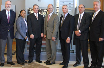 "On November 3rd, a group of dignitaries joined U.S. Secretary of Labor Thomas Perez when he visited the JATC's Lanham, MD training center. They included, from left David McKay, chairman of the JATC Trust Fund (JATTF), and president/CEO of Mona Electric Group; Kevin Burton, Assistant Director of JATC; Charles E. ""Chuck"" Graham, Business Manager, IBEW Local 26; Secretary Perez; Andrew A. Porter; Executive Director, Washington, D.C. Chapter, NECA; Rhett Roe, Director of JATC; and Steve Kelly Sr., President, Kelly Electric."