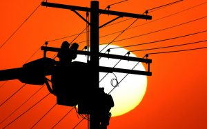 Man working on electric wires in the heat